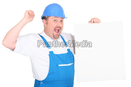 a cheerful tradesman holding up a