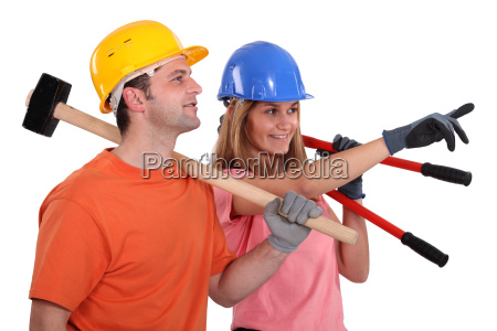 two builders pointing