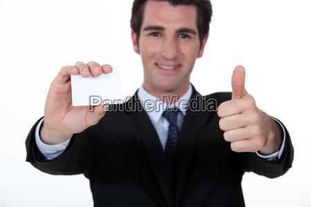 businessman advertising his company via business