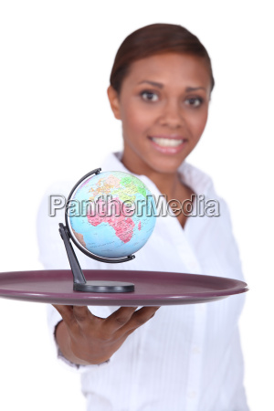 woman holding tray with globe on