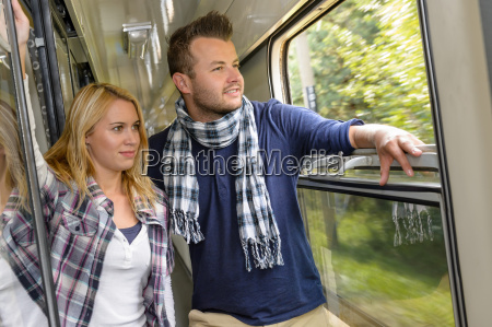 couple looking out the train window