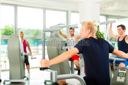 people in sport gym on the
