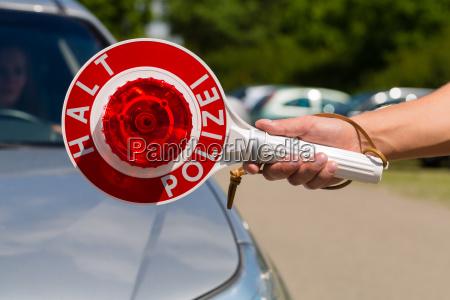 policeman or police patrol car stops