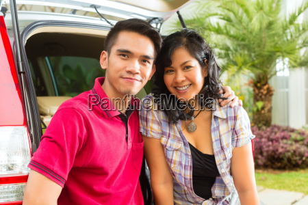 asian couple is happy in front