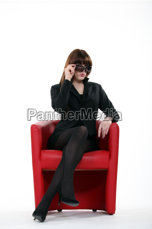 a businesswoman with sunglasses on