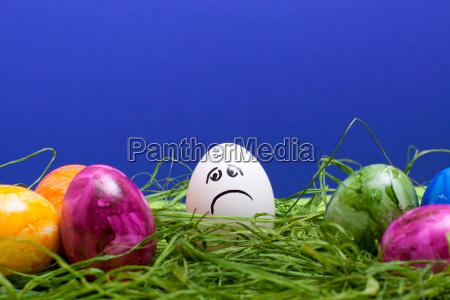 dunkeblue easter background with sad egg