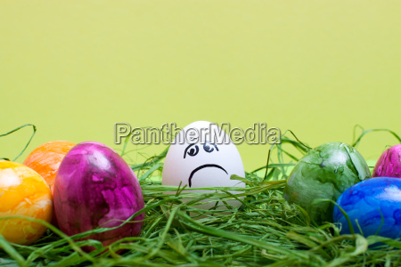 light green easter background with sad