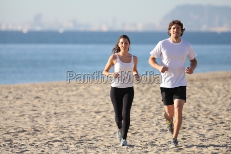 man and woman running in the