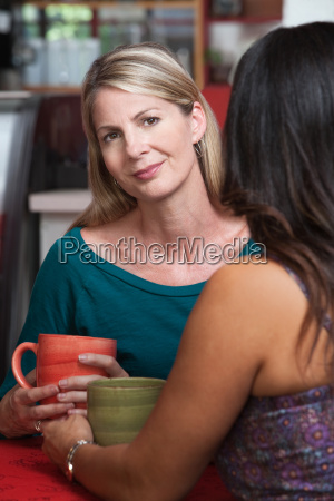 calm blond woman with friend