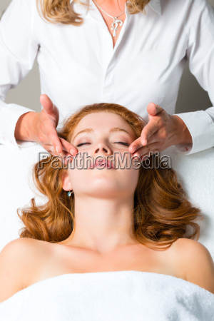 wellness woman receiving head massage