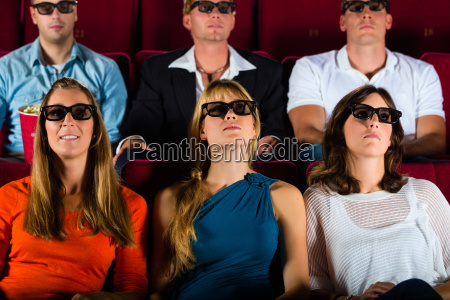 young people watch a 3d movie