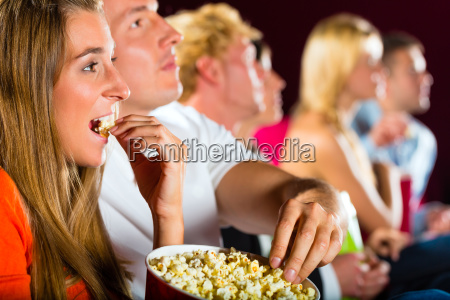 young people watch a movie at