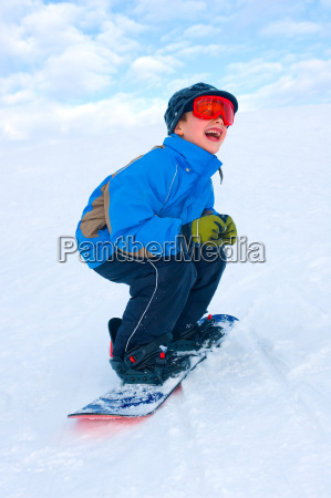boy is snowboarding