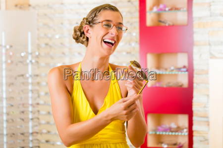 young woman at the opticians buying