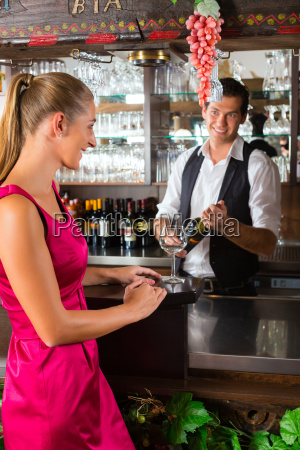 woman ordered glass of wine at