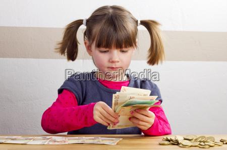 girl counts bills