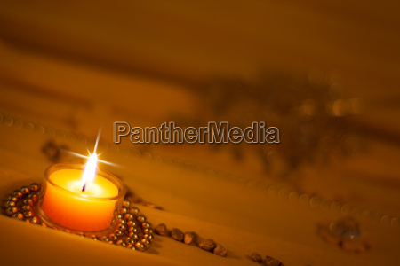 golden background candle gives romantic light
