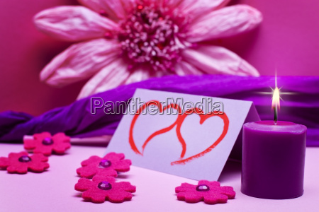 romantic pink pink background with candle