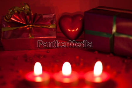 red background with candles and heart