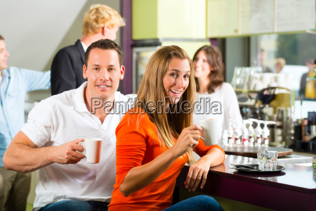 people in the cafe drinking coffee