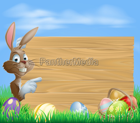 easter bunny and eggs with wooden