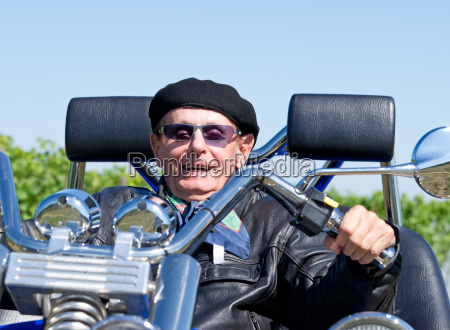 happy senior on trike