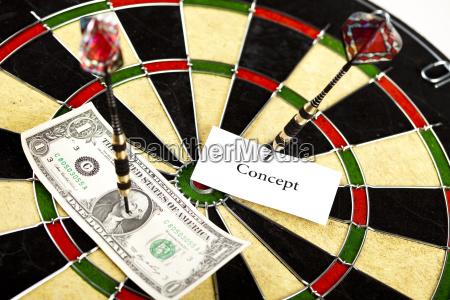 darts target and dollar in bulls