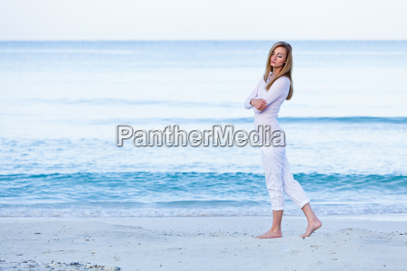 young attractive blonde woman walks on