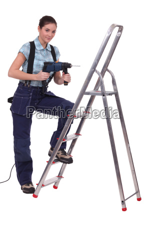 woman with a drill and steps