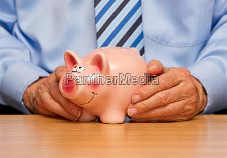 man with piggy bank savings