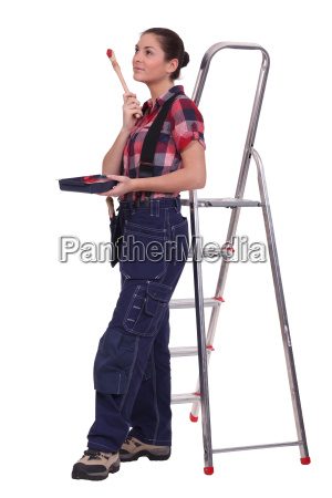 young woman stood by ladder with