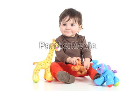 bebe que joga com brinquedos coloridos