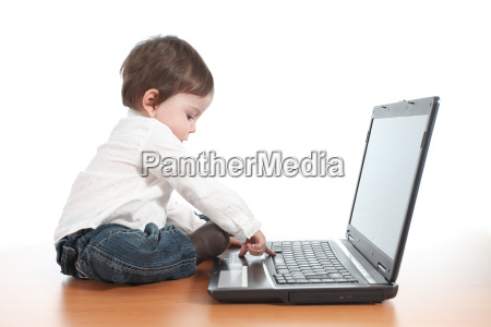 casual baby typing on a laptop