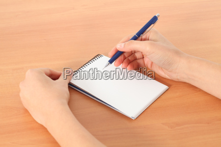 woman hands writing in a notebook
