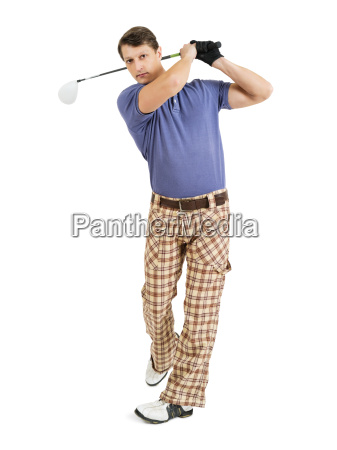 swinging a golf club