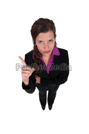 businesswoman shaking her finger