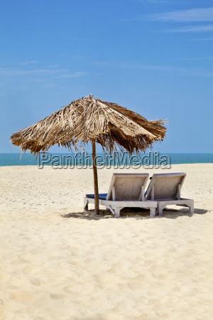 vertical landscape sea sand beach loungers