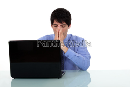 man having problems with his laptop