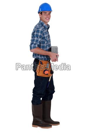 worker holding concrete block
