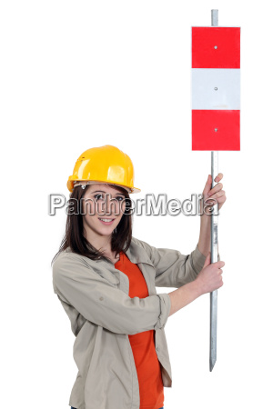woman showing roadsign for safety zone