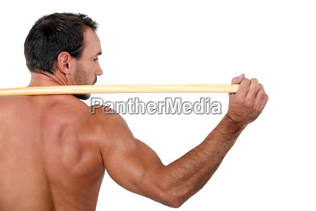 man working out with a wooden