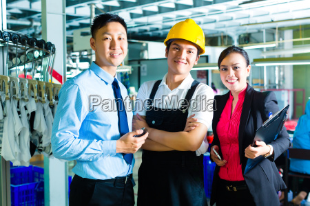 workers production manager and owner in