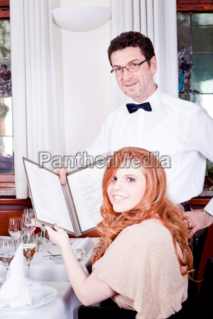 woman and man having dinner in