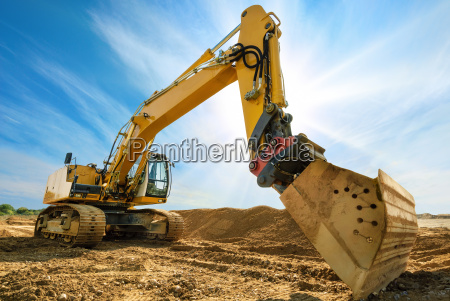 big excavator against blue sky