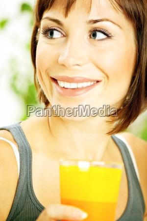 healthy girl drinking orange juice