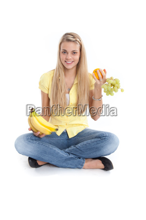 young woman with southern fruits sits