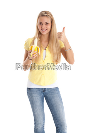 positive young woman with banana