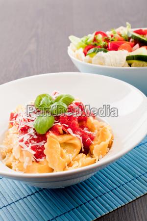 fresh homemade pastas ravioli with tomato