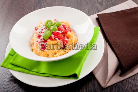 fresh homemade pasta ravioli with tomato