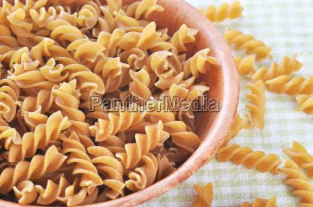 wholemeal fusilli italian pasta in bowl